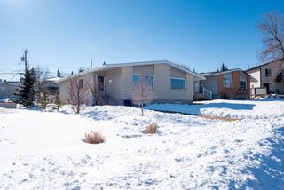 Photo 1: 515 34 Avenue NE in Calgary: Winston Heights/Mountview Semi Detached for sale : MLS®# A1072025