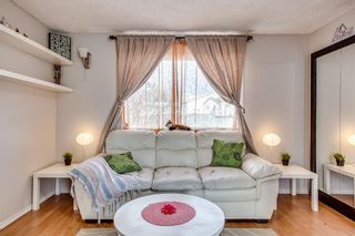 Photo 11: 111 ERIN RIDGE Road SE in Calgary: Erin Woods House for sale : MLS®# C4162823