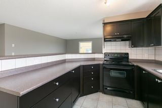 Photo 3: 8329 304 MACKENZIE Way SW: Airdrie Apartment for sale : MLS®# A1128736