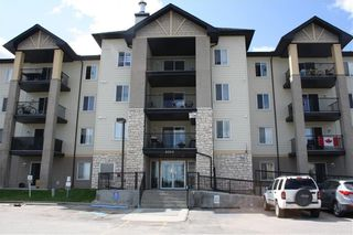 Photo 1: 6109 304 Mackenzie Way SW: Airdrie Apartment for sale : MLS®# C4293659