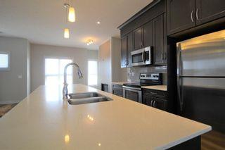 Photo 8: 296 Silverado Plains Park SW in Calgary: Silverado Row/Townhouse for sale : MLS®# A1065666
