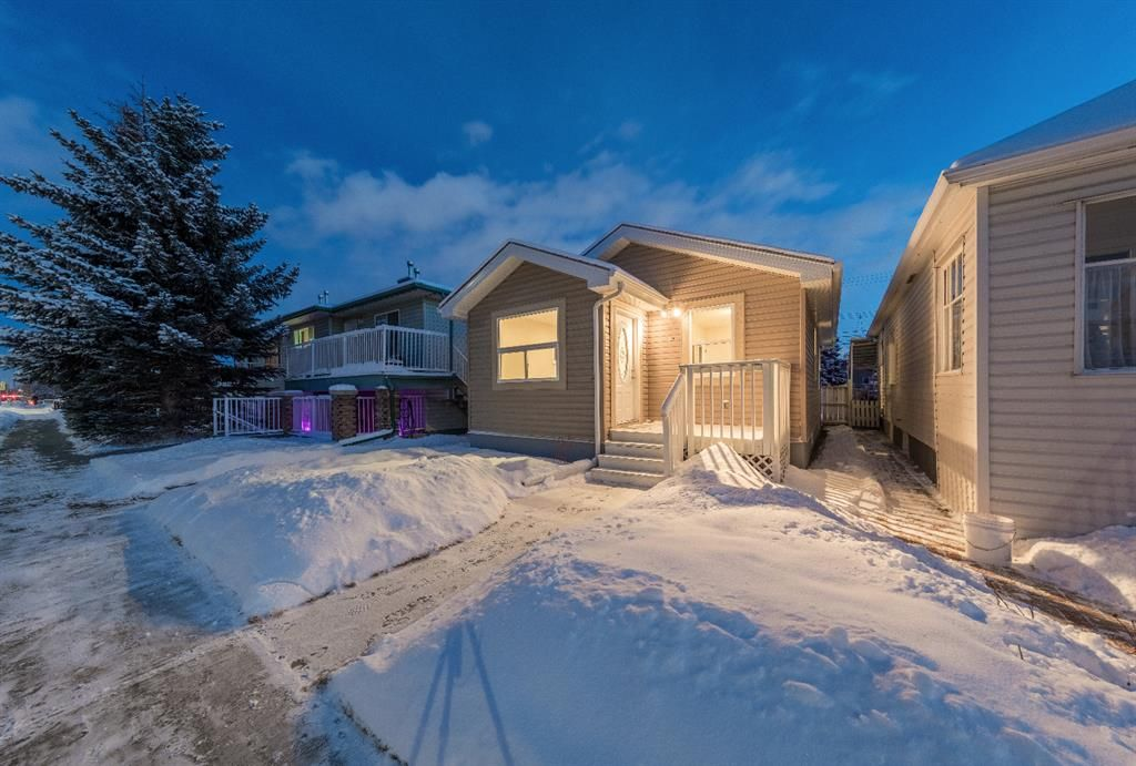 Main Photo: 129 20 Avenue NE in Calgary: Tuxedo Park Detached for sale : MLS®# A1066755