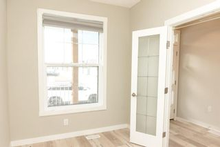 Photo 5: 166 Howse Common in Calgary: Livingston Detached for sale : MLS®# A1143791