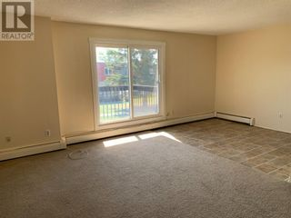 Photo 4: 21, 616 Main Street NW in Slave Lake: Condo for sale : MLS®# A1137096