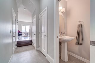 Photo 5: 907 Jumping Pound Common: Cochrane Row/Townhouse for sale : MLS®# A1132952