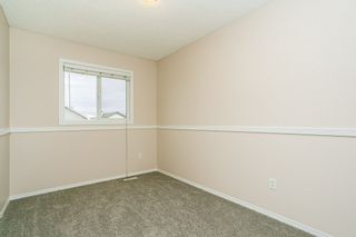 Photo 24: #84 2503 24 ST NW in Edmonton: Zone 30 House Half Duplex for sale