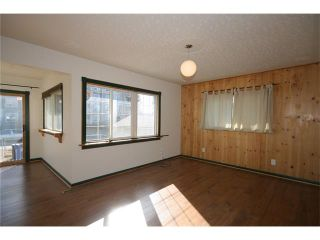 Photo 8: 112 POWELL Street: Cochrane House for sale : MLS®# C4052948