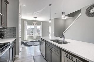 Photo 8: 26 Evanscrest Heights NW in Calgary: Evanston Detached for sale : MLS®# A1127719