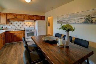Photo 6: 50 FRASER Road SE in Calgary: Fairview Detached for sale : MLS®# A1145619