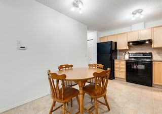Photo 18: 218 950 ARBOUR LAKE Road NW in Calgary: Arbour Lake Row/Townhouse for sale : MLS®# A1136377