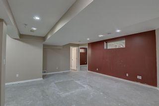 Photo 36: 128 Rainbow falls Grove E: Chestermere Duplex for sale : MLS®# A1154026