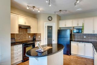 Photo 6: 80 Everglen Close SW in Calgary: Evergreen Detached for sale : MLS®# A1124836