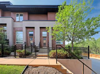 Photo 1: 27 Aspen Hills Common SW in Calgary: Aspen Woods Row/Townhouse for sale : MLS®# A1134206
