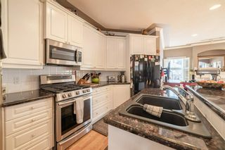 Main Photo: 2203 4 Avenue NW in Calgary: West Hillhurst Semi Detached for sale : MLS®# A1095771