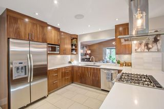 Photo 14: 1306 Hamilton Street NW in Calgary: St Andrews Heights Detached for sale : MLS®# A1151940