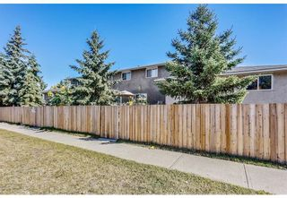 Photo 3: 11404 ELBOW Drive SW in Calgary: Southwood Multi Family for sale : MLS®# A1100297