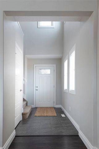 Photo 2: 7247 Armour Crescent SW in Edmonton: Zone 56 House Half Duplex for sale : MLS®# E4240443