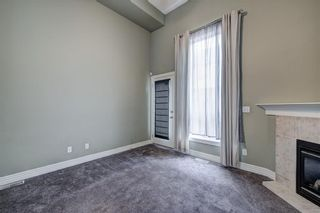 Photo 5: 312 BRIDLEWOOD Lane SW in Calgary: Bridlewood Row/Townhouse for sale : MLS®# A1046866
