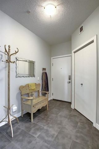 Photo 4: 2231 604 East Lake Boulevard NE: Airdrie Apartment for sale : MLS®# A1045955