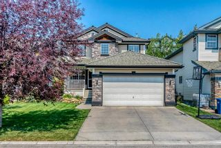 Photo 1: 7760 Springbank Way SW in Calgary: Springbank Hill Detached for sale : MLS®# A1132357