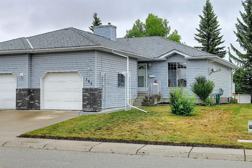 Main Photo: 184 Woodside Close NW: Airdrie Semi Detached for sale : MLS®# A1137637