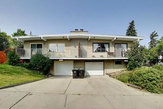 Photo 1: 7011 HUNTERVILLE Road NW in Calgary: Huntington Hills Semi Detached for sale : MLS®# A1035276
