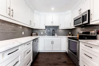 Photo 1: 1441 Ranchlands Road NW in Calgary: Ranchlands Row/Townhouse for sale : MLS®# A1061548