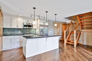 Photo 2: 303 2100A Stewart Creek Drive: Canmore Apartment for sale : MLS®# A1113991