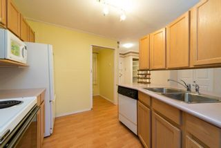 """Photo 2: 106 558 ROCHESTER Avenue in Coquitlam: Coquitlam West Condo for sale in """"CRYSTAL COURT"""" : MLS®# R2019234"""