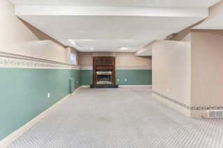 Photo 15: 51 SANDRINGHAM Way NW in Calgary: Sandstone Valley House for sale