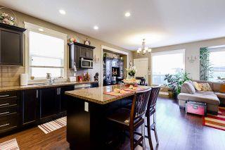 Photo 3: 7310 192 Street in Surrey: Clayton 1/2 Duplex for sale : MLS®# R2559075