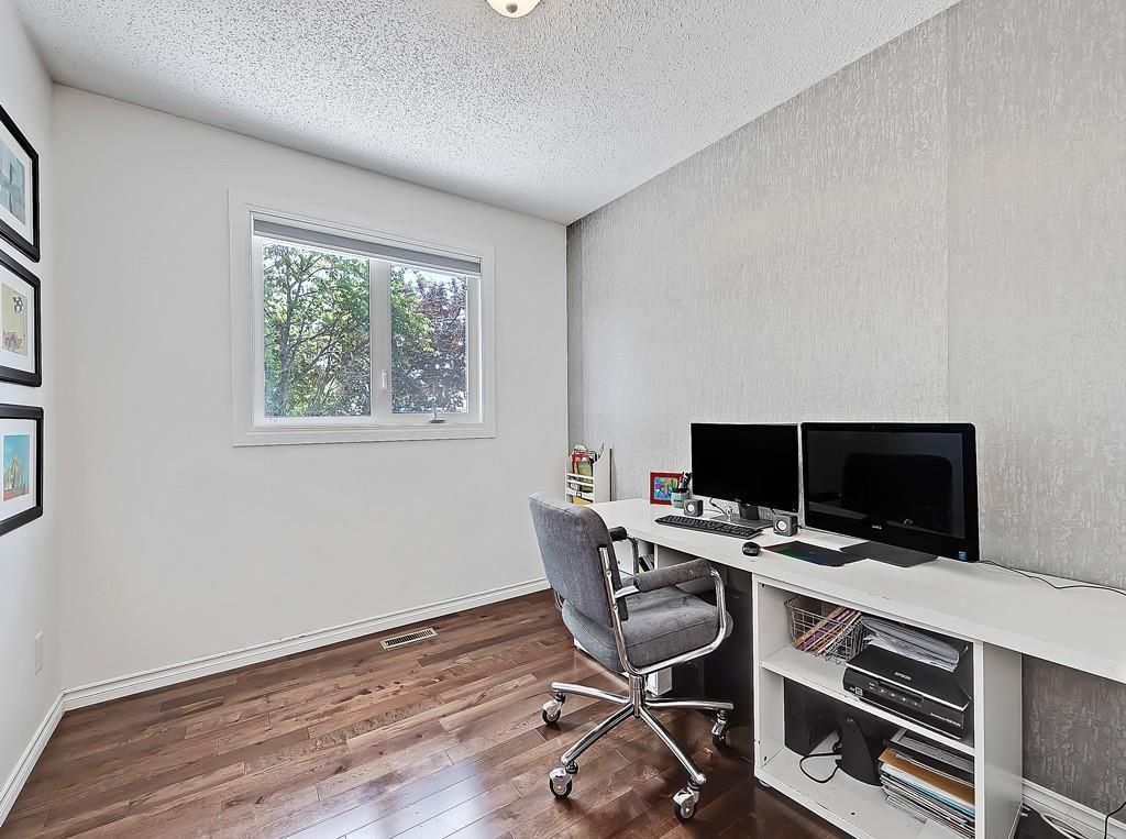 Photo 18: Photos: 7607 68 Avenue NW in Calgary: Silver Springs Detached for sale : MLS®# A1024824