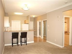 Photo 7: 2131 1010 ARBOUR LAKE Road NW in Calgary: Arbour Lake Apartment for sale : MLS®# C4254422