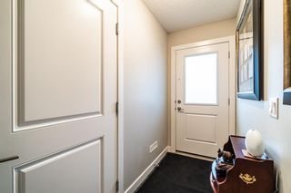 Photo 5: 374 Nolancrest Heights NW in Calgary: Nolan Hill Row/Townhouse for sale : MLS®# A1145723