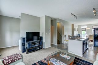 Photo 10: 1002 125 PANATELLA Way NW in Calgary: Panorama Hills Row/Townhouse for sale : MLS®# A1120145