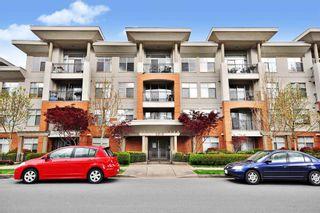 """Photo 1: 204 33545 RAINBOW Avenue in Abbotsford: Central Abbotsford Condo for sale in """"Tempo"""" : MLS®# R2606221"""