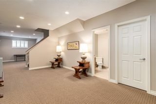 Photo 31: 230 SOMME Avenue SW in Calgary: Garrison Woods Row/Townhouse for sale : MLS®# C4261116