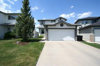 Photo 1: 218 ARBOUR RIDGE Park NW in Calgary: Arbour Lake House for sale : MLS®# C4186879