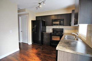 Photo 7: 157 Copperpond Heights SE in Calgary: Copperfield Row/Townhouse for sale : MLS®# A1090874