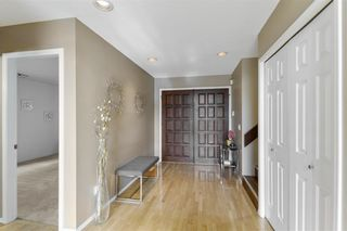 Photo 2: 2544 BLUEBELL Avenue in Coquitlam: Summitt View House for sale : MLS®# R2625984