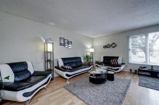 Photo 3: 14703 Deer Ridge Drive SE in Calgary: Deer Ridge Detached for sale : MLS®# A1126639
