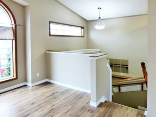 Photo 2: 107 Mt Allan Circle SE in Calgary: McKenzie Lake Detached for sale : MLS®# A1068557