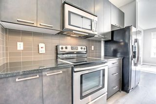 Photo 10: 1823 Copperfield Boulevard SE in Calgary: Copperfield Row/Townhouse for sale : MLS®# A1149054