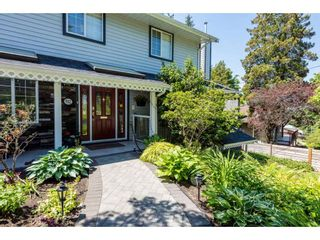 """Photo 2: 932 THERMAL Drive in Coquitlam: Chineside House for sale in """"Chineside"""" : MLS®# R2374188"""