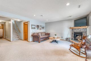 Photo 23: 210 Arbour Cliff Close NW in Calgary: Arbour Lake Semi Detached for sale : MLS®# A1086025