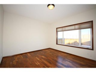 Photo 5: 103 WEST POINTE Court: Cochrane House for sale : MLS®# C4042878
