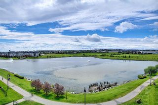 Photo 1: 2408 43 Country Village Lane NE in Calgary: Country Hills Village Apartment for sale : MLS®# A1057095