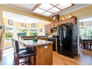 """Photo 3: 25120 57 Avenue in Langley: Salmon River House for sale in """"Strawberry Hills"""" : MLS®# R2500830"""