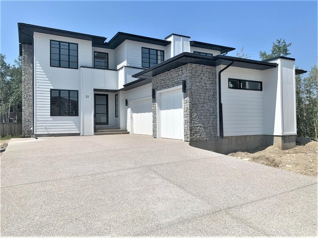 Main Photo: 31 Rockford Park NW in Calgary: Rocky Ridge Detached for sale : MLS®# A1151305