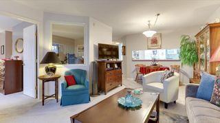 "Photo 5: 322 13880 70 Avenue in Surrey: East Newton Condo for sale in ""Chelsea Gardens"" : MLS®# R2591840"